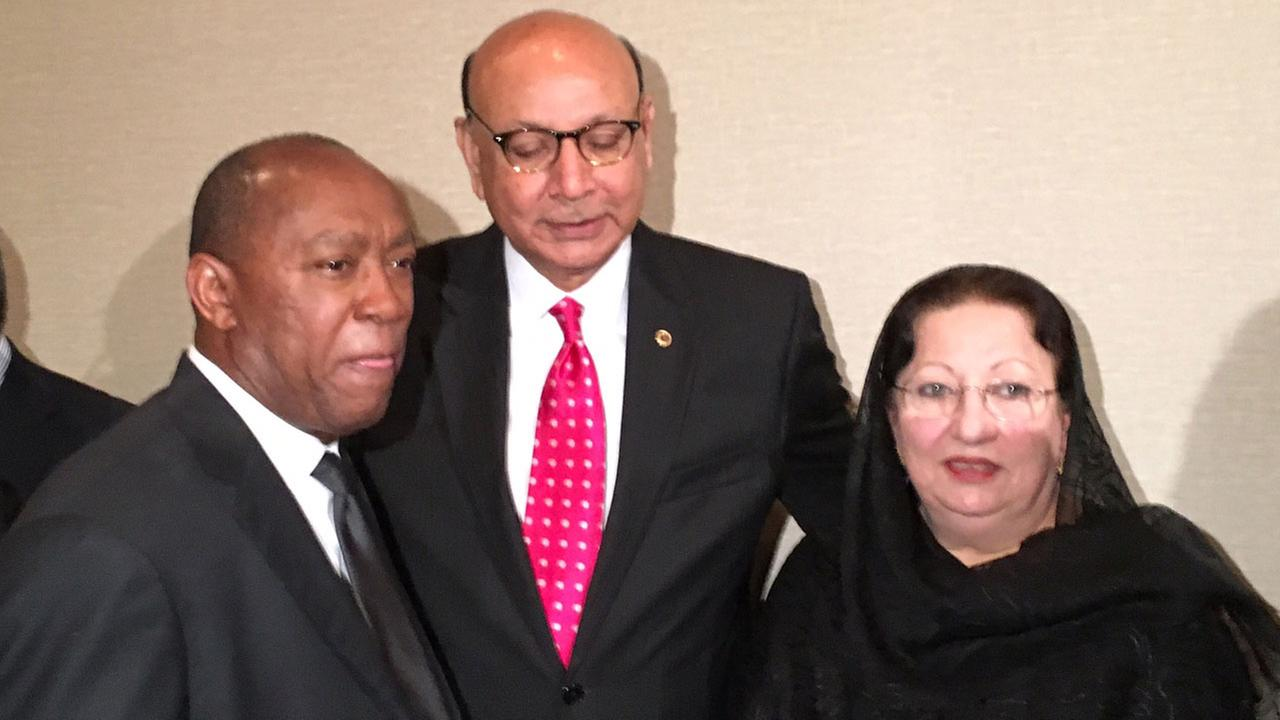 Khizer and Ghazala Khan pose for a photograph with Houston mayor Sylvester Turner.