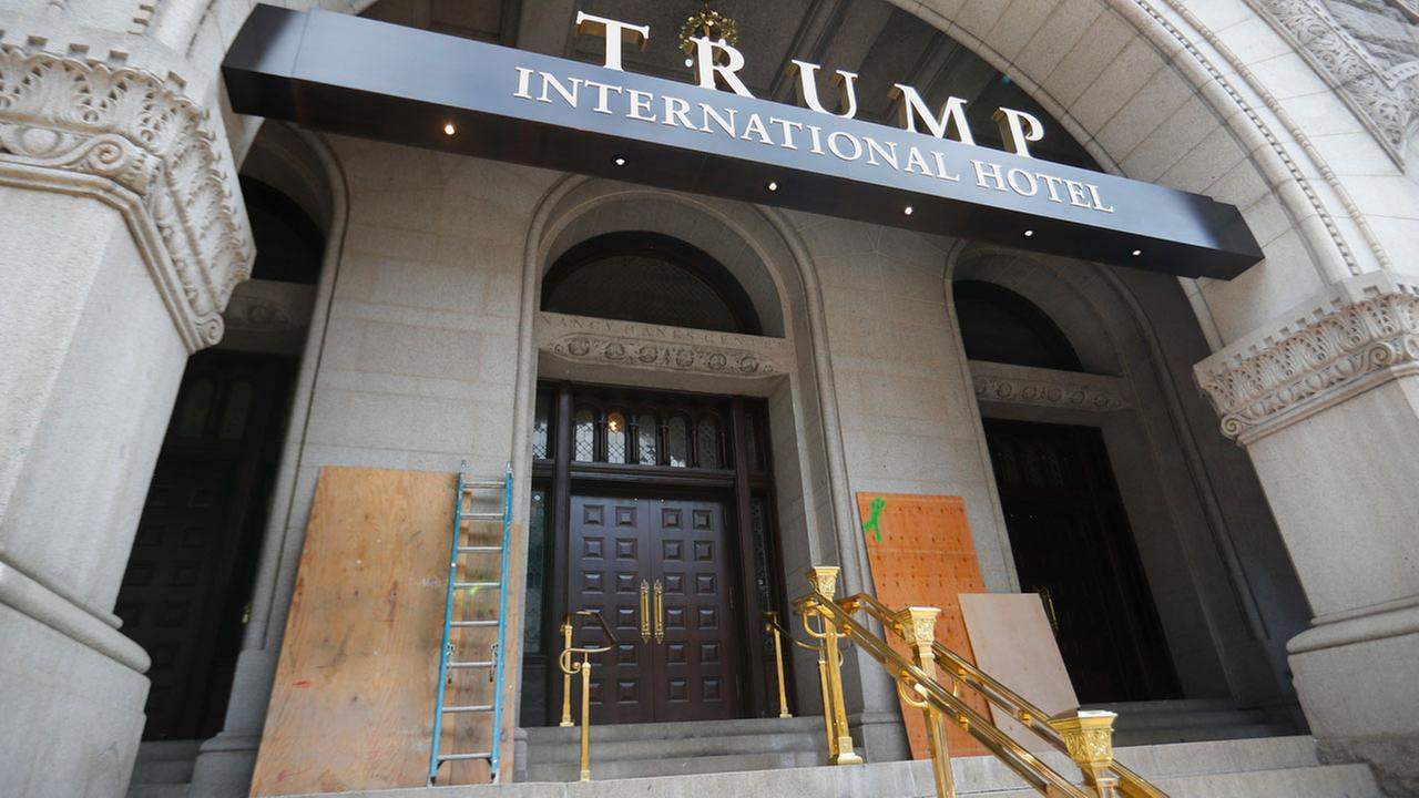 Plywood covers up graffiti at the entrance to the Trump International Hotel in Washington. Police said someone spray-painted black lives matter and no justice no peace.