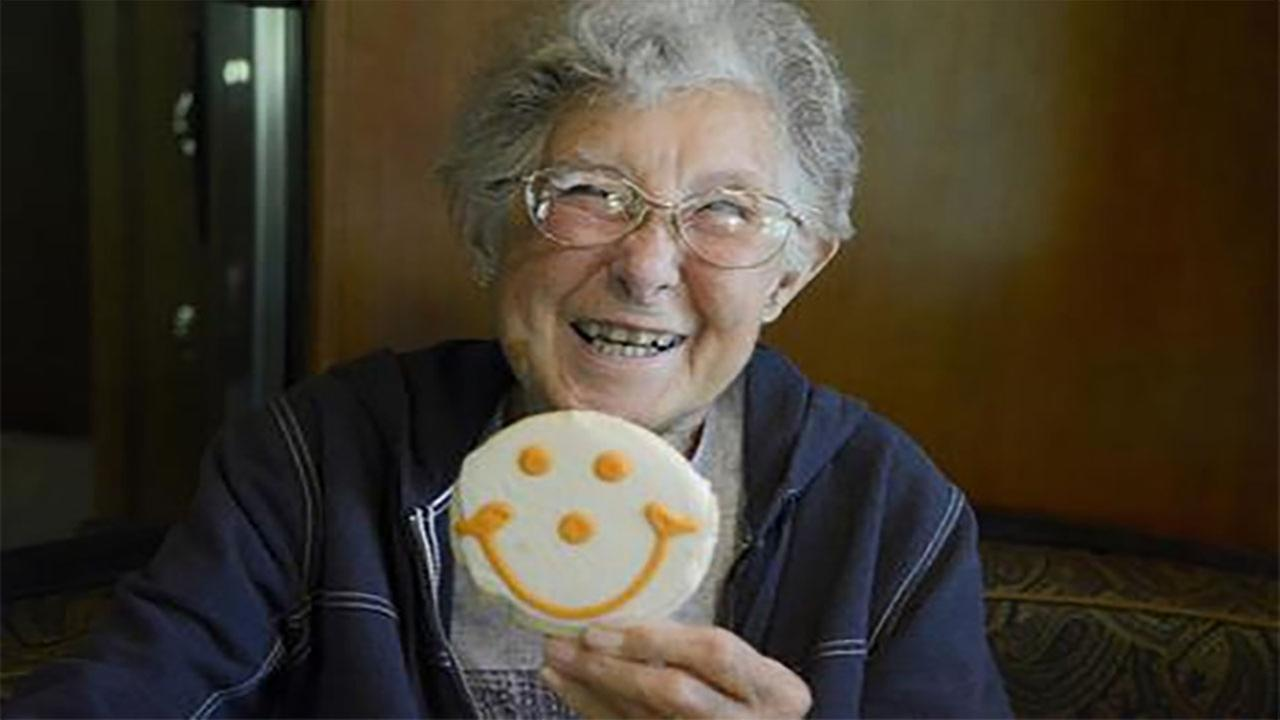 In this June 13, 2016, file photo, Norma Bauerschmidt holds up one of her favorite smiley-face cookies inside the familys recreational vehicle at the Bear Run Campground.