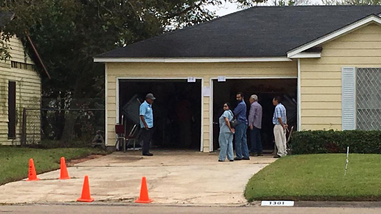Democracy is a neighborhood affair in one southwest Houston neighborhood where voters cast their ballot out of their neighbors garage.