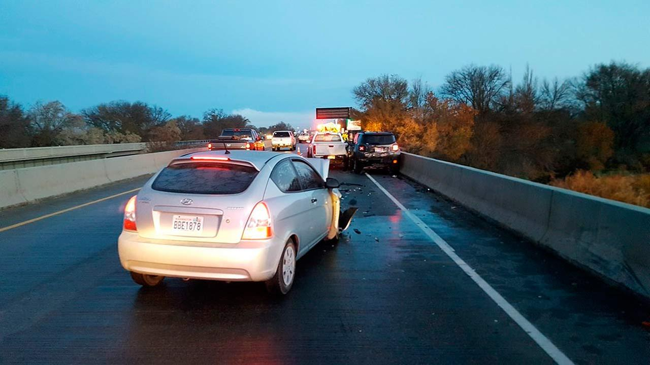 In this photo provided by Oregon State Police, a damaged car is shown on an Interstate 84 bridge over the Snake River on the Idaho/Oregon border near Ontario, Ore., Nov. 21, 2016.