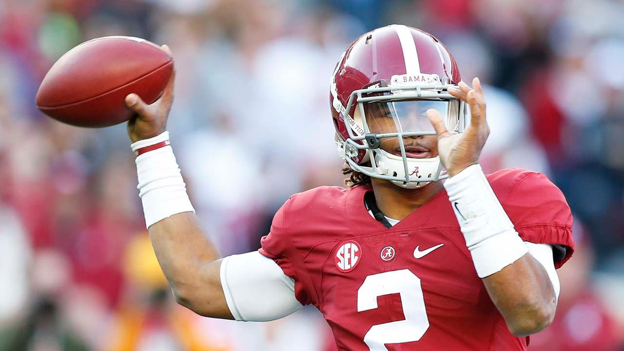 FILE: Alabama quarterback Jalen Hurts sets back to pass the ball during the first half of the Iron Bowl NCAA college football game, Saturday, Nov. 26, 2016, in Tuscaloosa, Ala.