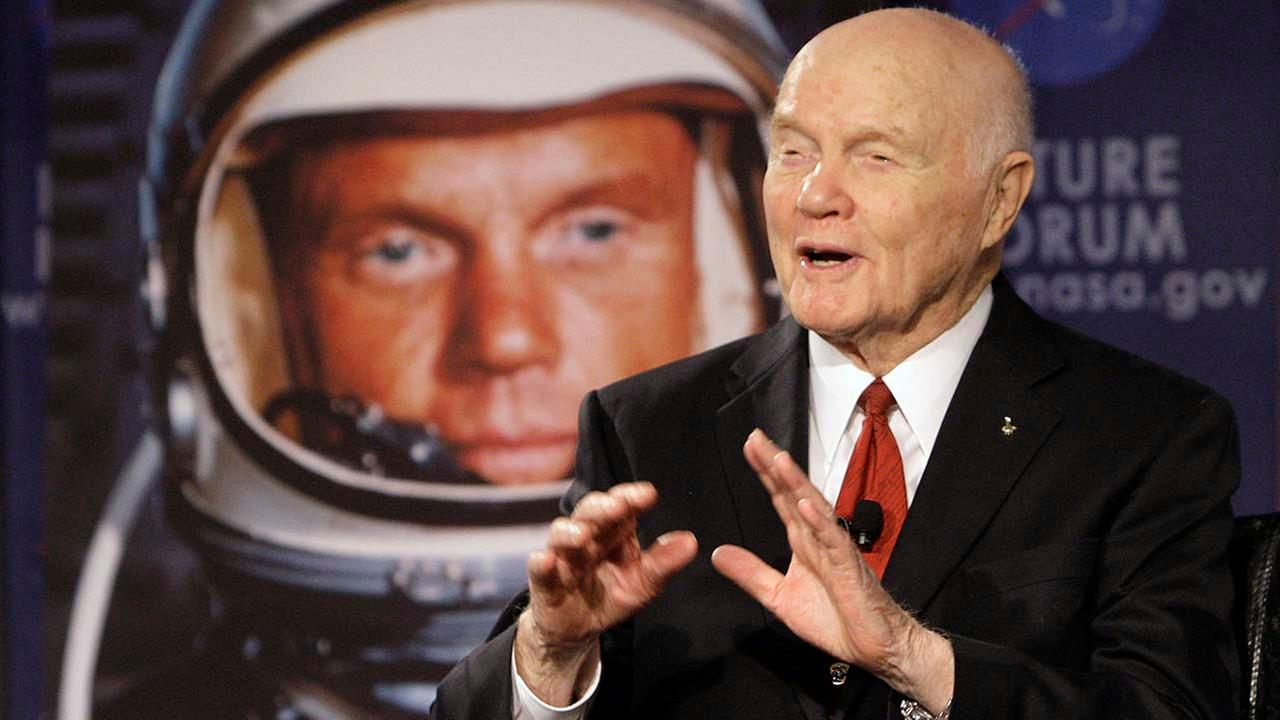 FILE - In this Feb. 20, 2012, file photo, U.S. Sen. John Glenn talks with astronauts on the International Space Station via satellite in Columbus, Ohio.