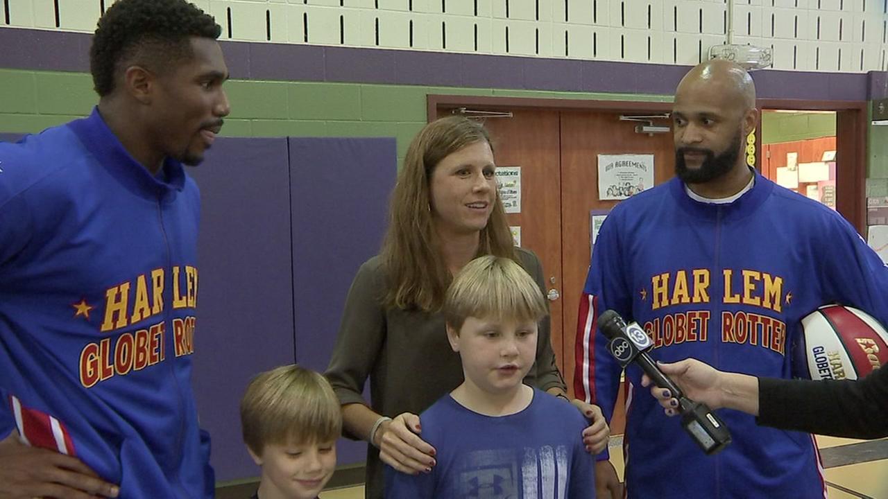 Harlem Globetrotters recognize fan, cancer survivor at Frostwood Elementary School