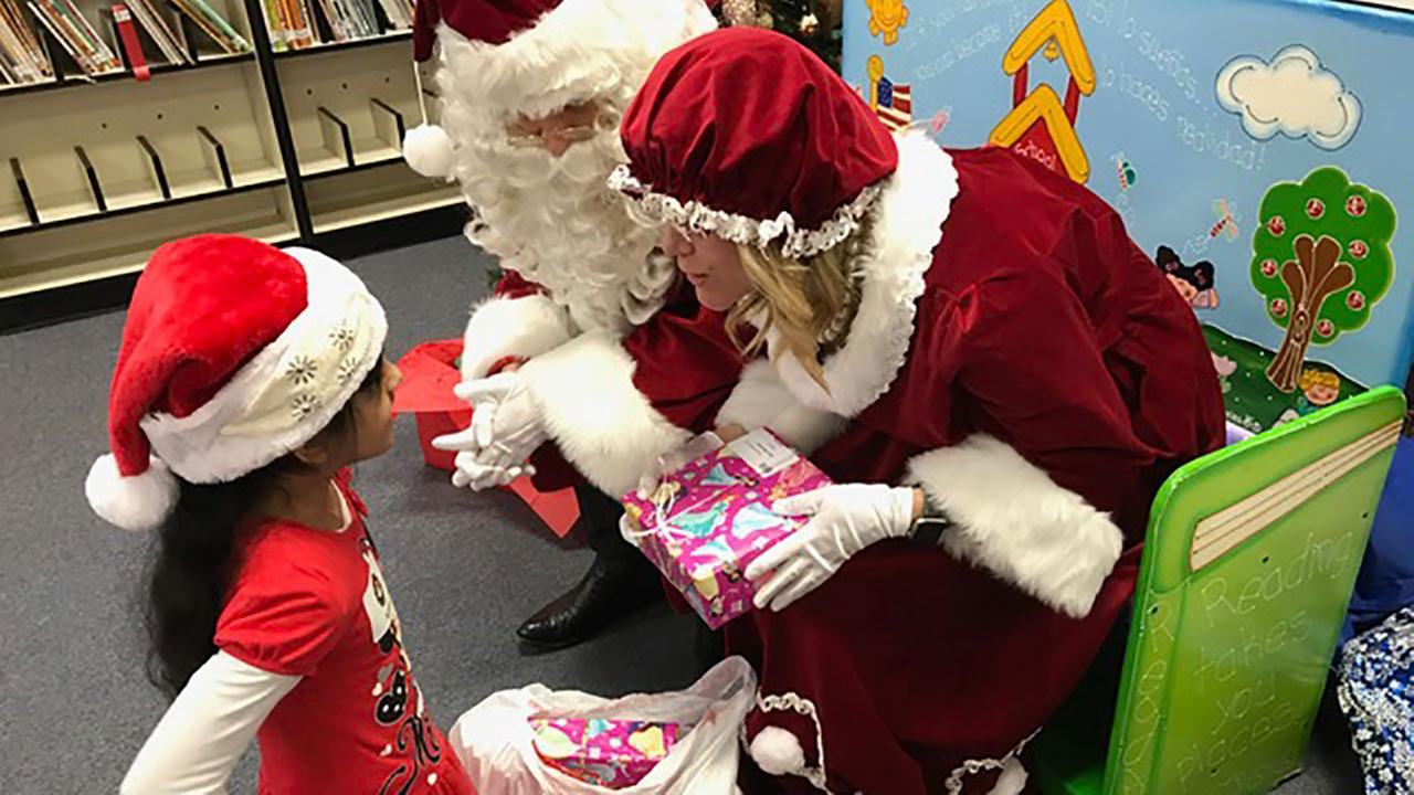 Local lawyers, businesses bring holiday magic to David Burnet Elementary students