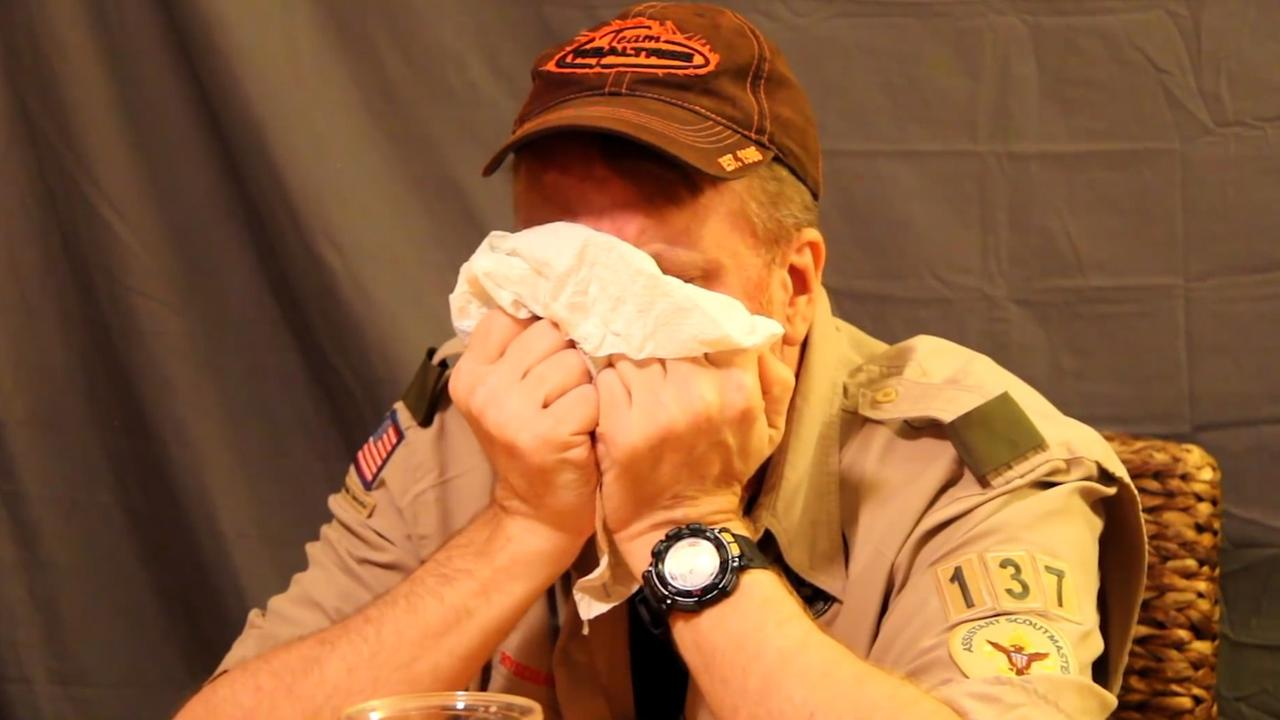 Boy Scout troop leader eats 23 ghost peppers to raise money