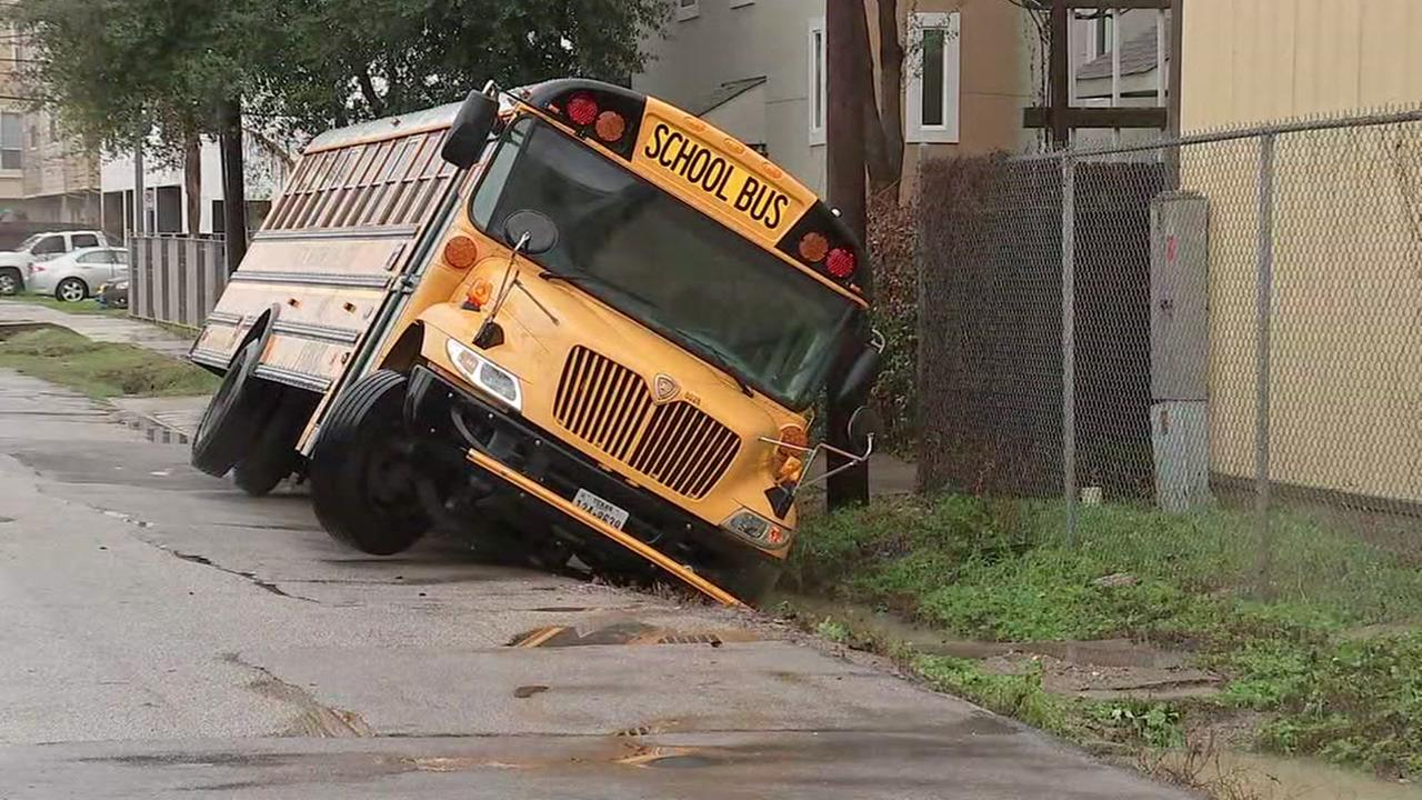 Bus nearly tips over in ditch in The Heights