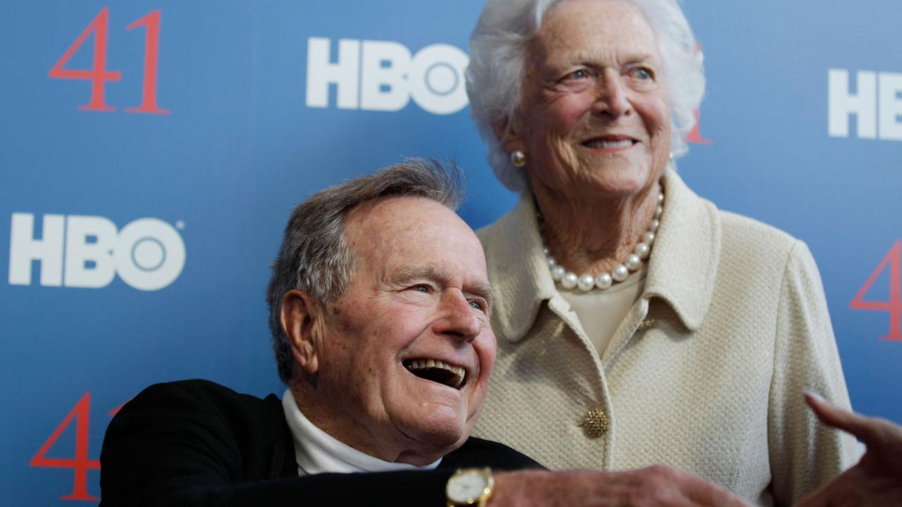 Former President George H.W. Bush and his wife former first lady Barbara Bush arrive for the 2012 premiere of HBOs new documentary on his life near the family compound in Maine.