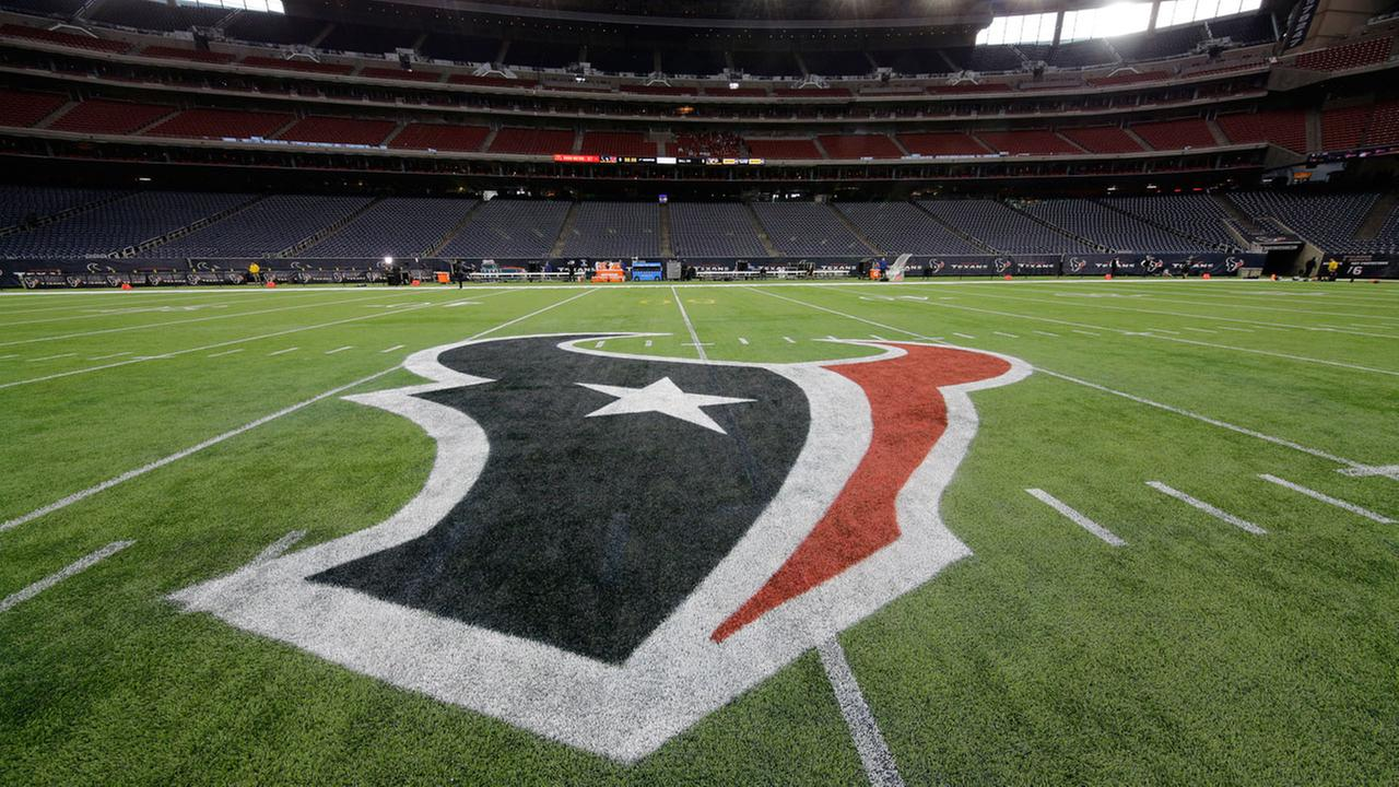 The Houston Texans logo is seen of the field at NRG Stadium before an NFL football game between the Houston Texans and the Jacksonville Jaguars, Sunday, Jan. 3, 2016, in Houston.