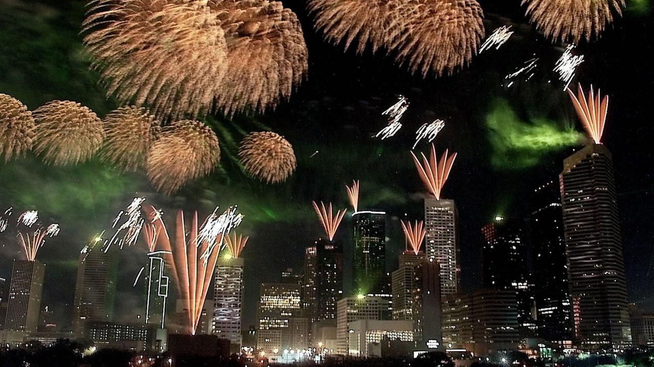 Fireworks and lasers illuminate the Houston skyline during the Reliant Energy Power of Houston Sky Power and Beyond show Saturday, Oct. 23, 1999.
