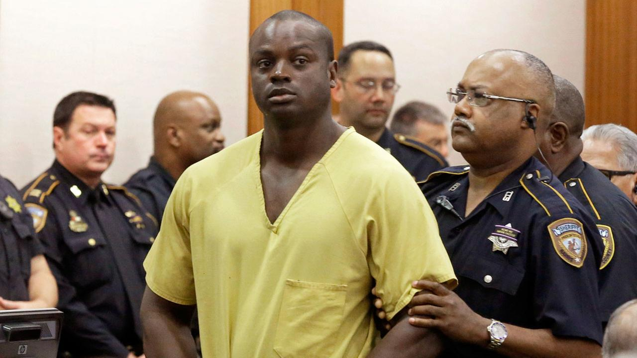 In this Aug. 31, 2015 file photo, Shannon Miles is escorted out of a courtroom after a hearing in Houston.