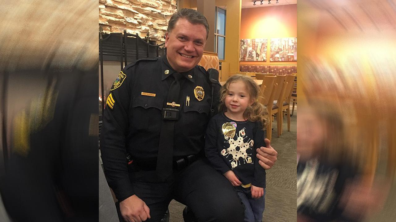 Police officer has adorable dinner date with girl