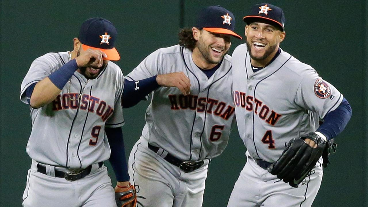Houston Astros outfielders Marwin Gonzalez, (9) Jake Marisnick (6) and George Springer (4) celebrate after the Astros beat the Seattle Mariners 7-5.