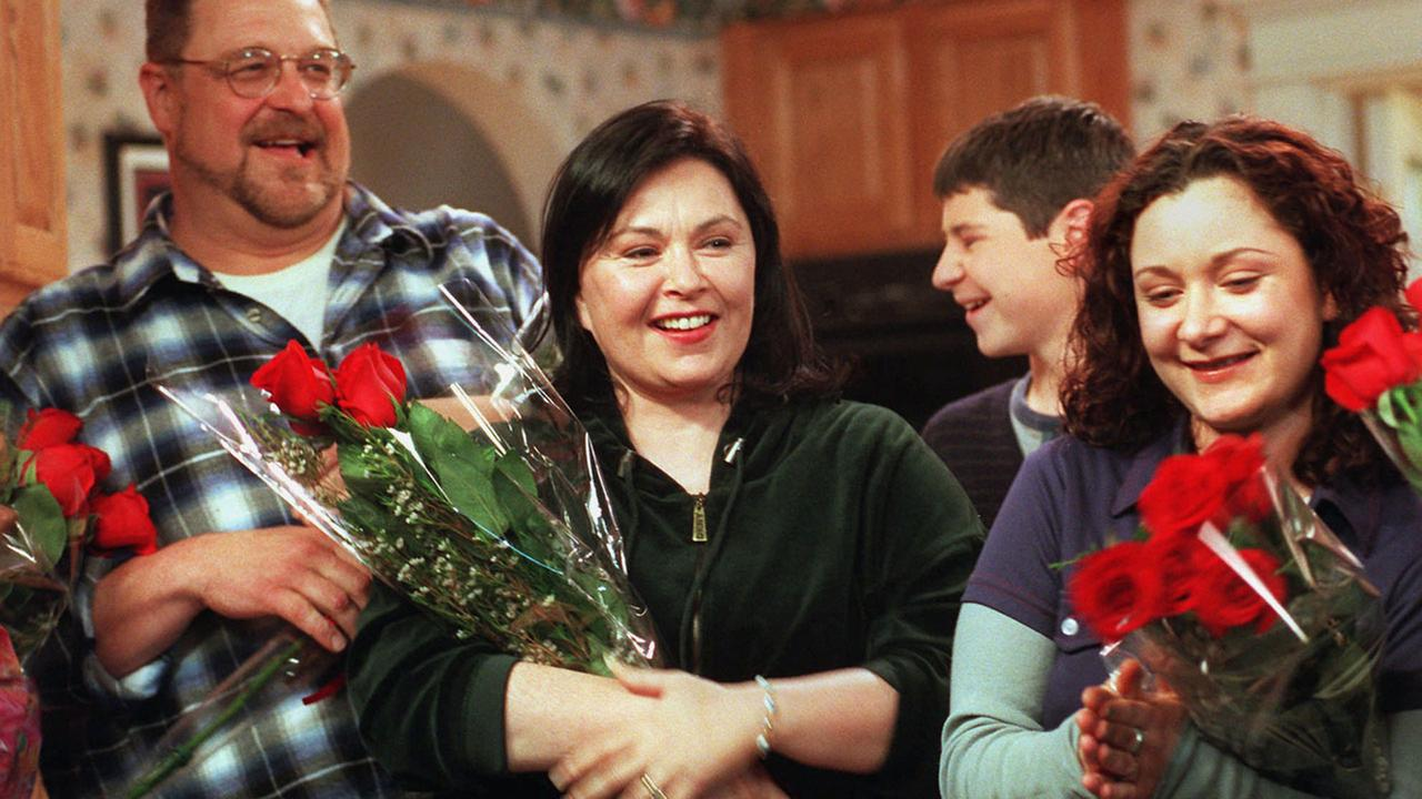 Roseanne Barr, star of the longtime ABC sitcom Roseanne, basks in applause with co-stars John Goodman, left, and Sara Gilbert after taping the series finale.