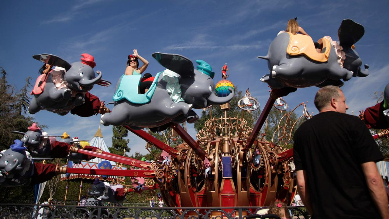 Visitors ride the Dumbo the Flying Elephant ride at Disneyland in Anaheim, Calif. in 2015.