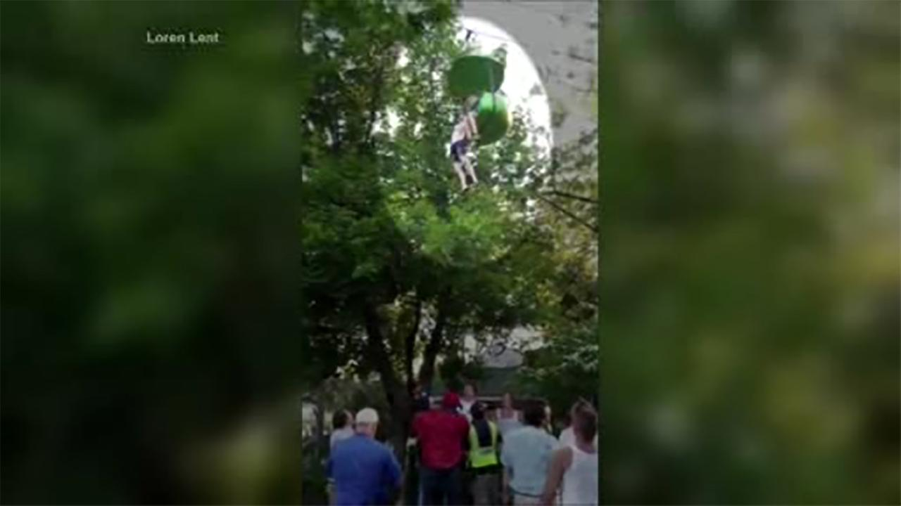 Bystanders race to catch teen falling from ride at Six Flags.
