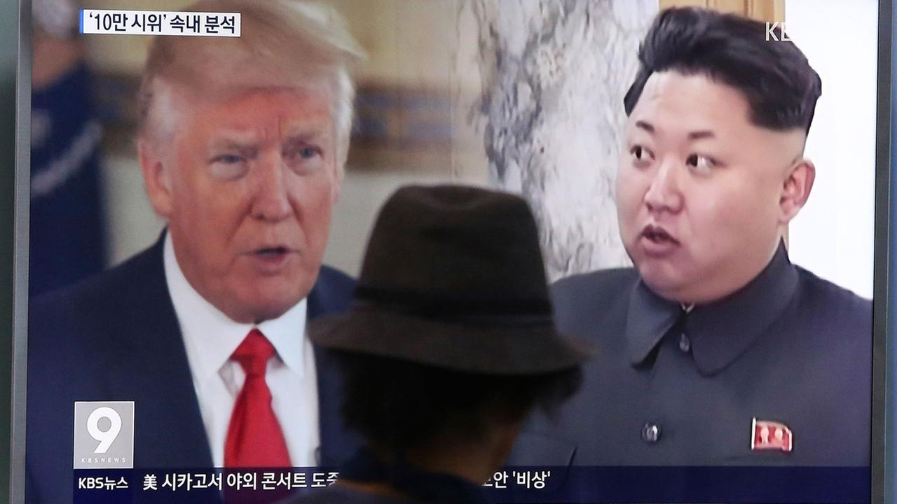 A man watches a television screen showing U.S. President Donald Trump, left, and North Korean leader Kim Jong Un during a news program in Seoul, South Korea
