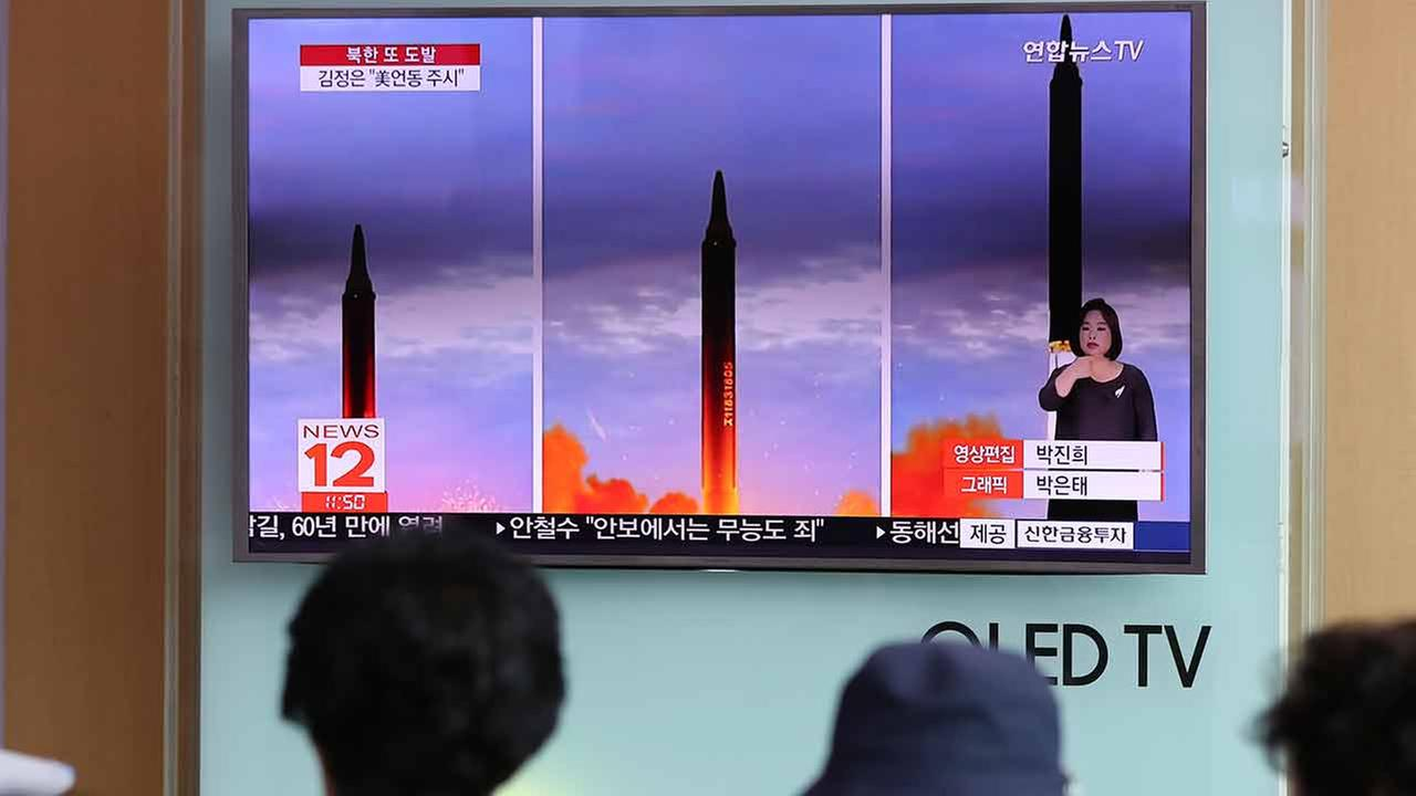 People watch a TV screen showing a local news program reporting about North Koreas missile launch at Seoul Train Station in Seoul, South Korea, Wednesday, Aug. 30, 2017.
