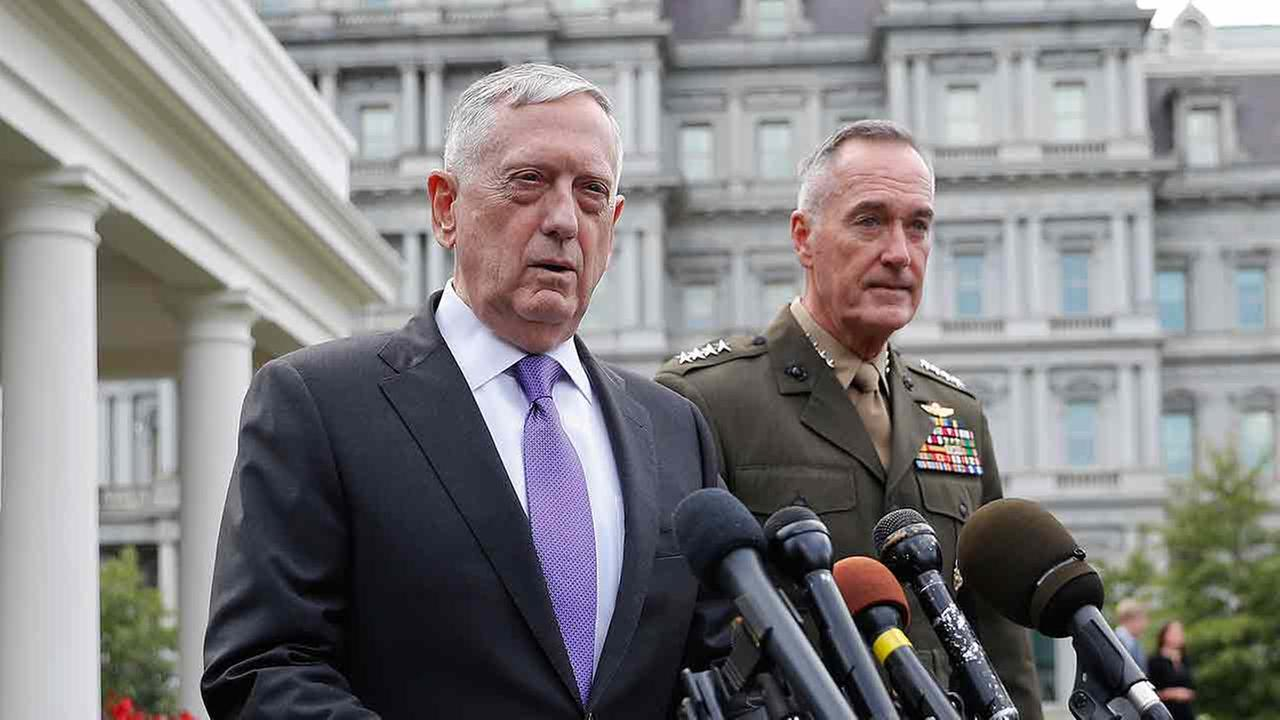 Defense Secretary Jim Mattis, left, accompanied by Joint Chiefs Chairman Gen. Joseph Dunford, right, makes a statement to members of the media outside the White House.
