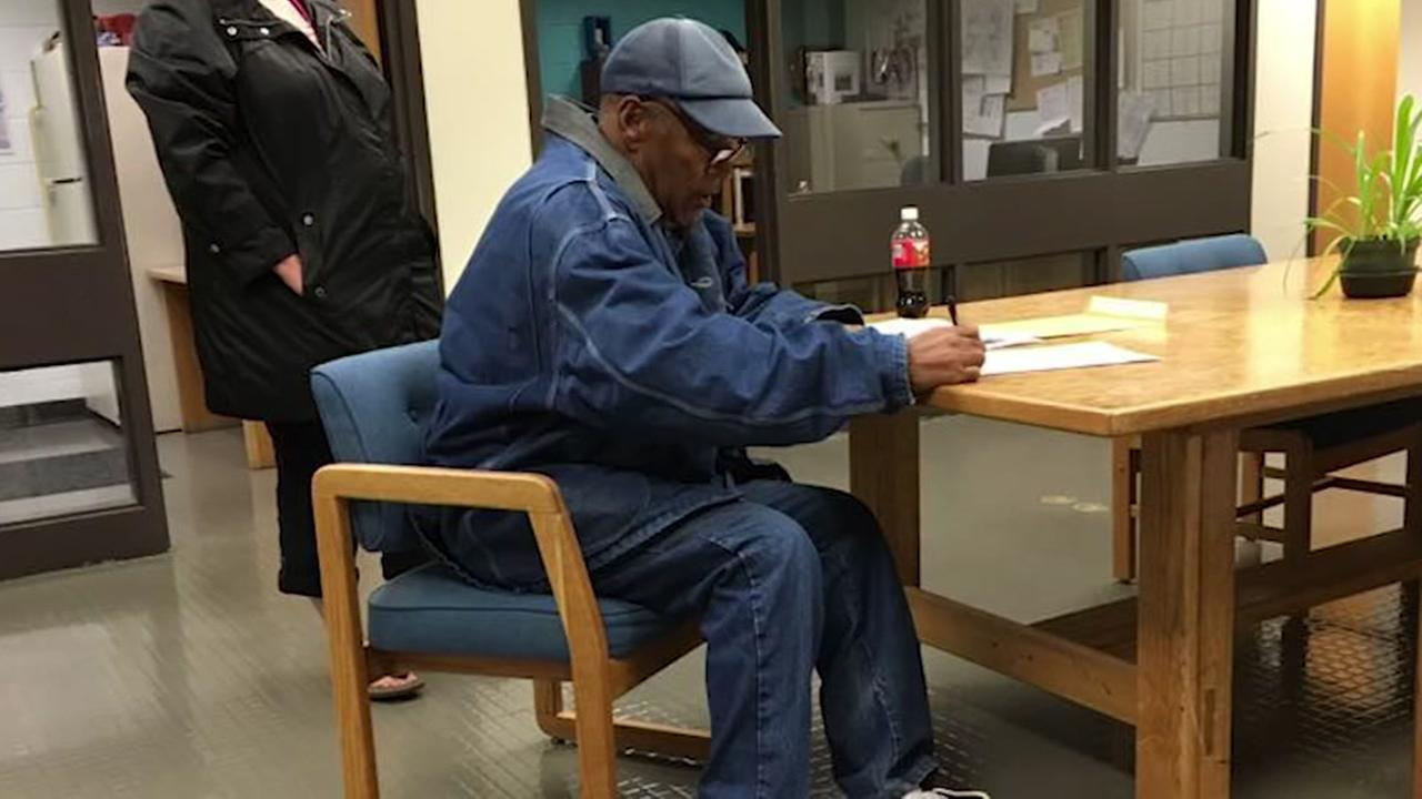 O.J. Simpson signs paperwork before his release from a Las Vegas prison October 1, 2017.