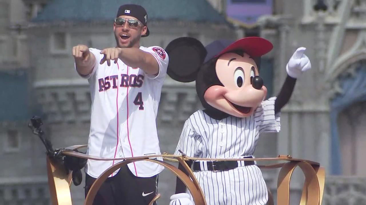 Astros George Springer and Mickey Mouse greeted the crowds on Main Street USA during a parade honoring the World Series champs at Walt Disney Worlds Magic Kingdom.