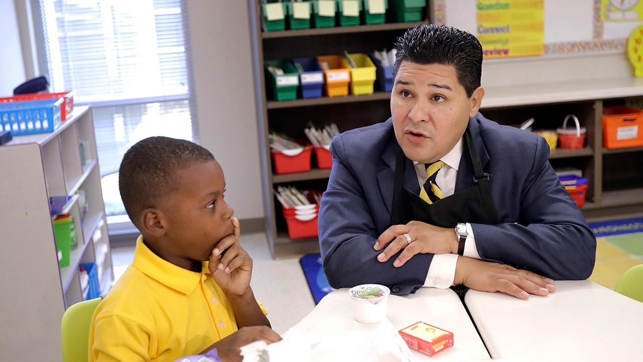 HISD superintendent Richard Carranza sits next to a student in an undated photo.