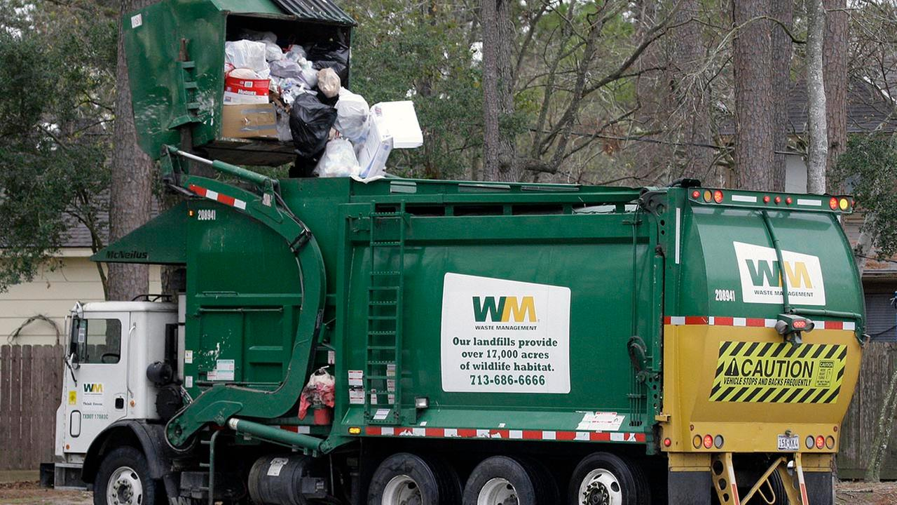 A recycling truck picks up trash in Houston in this undated file photo.