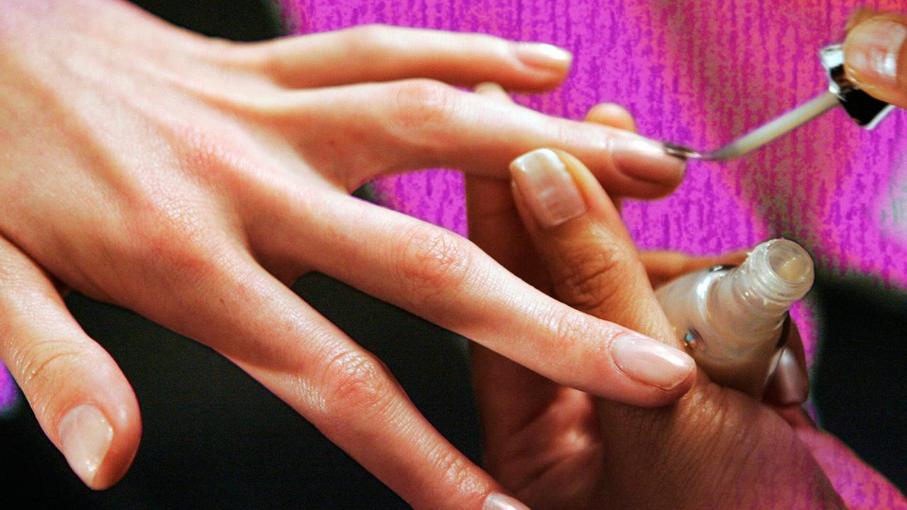 woman painting nails