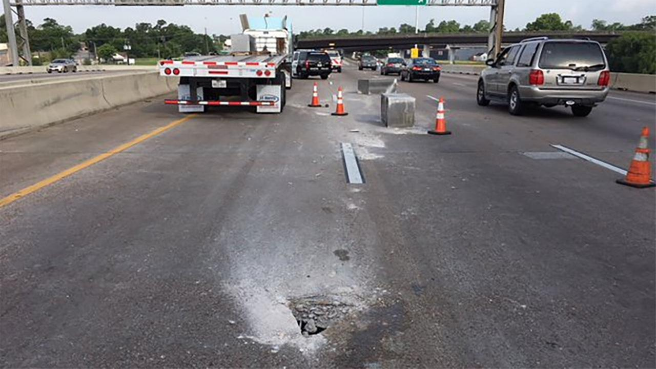 Lost load of concrete damages road, shutting down North Loop lanes for the day