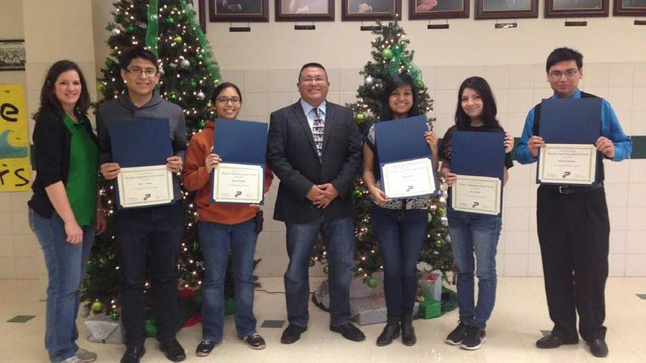 Nicole Shuler, PHS Assistant Principal; student Jose Sanchez; student Alexus Garcia; Joe Saavedra, PHS Principal; student Cynthia Moreno; student Evelyn Ibanez and student Abelardo