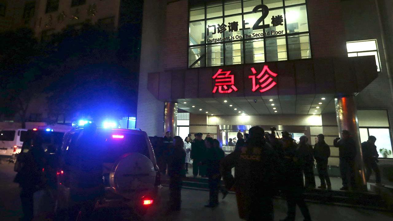 In this photo released by Chinas Xinhua News Agency, medical workers stand outside the emergency ward of the No. 1 Peoples Hospital of Shanghai after a stampede