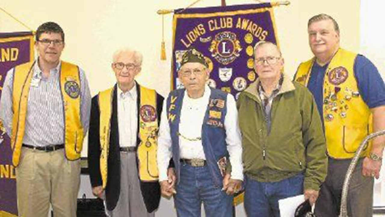 Cleveland Lions Club President Thomas Higgins (left) and club member Mike Penry (right) welcomed local World War II veterans John Wuensche, E.T. Clark and Cliff Morris