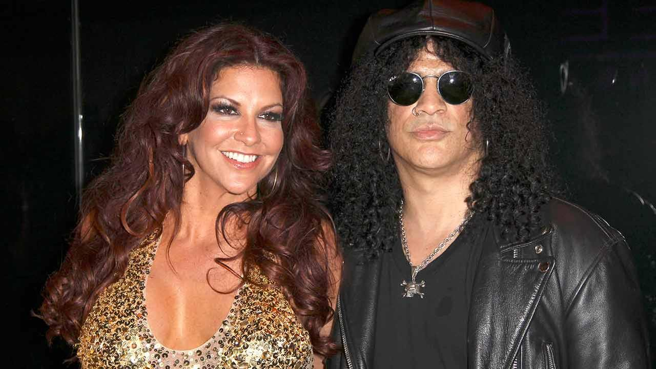 In this March 31, 2012 file photo, musician Slash right, and Perla Hudson arrives at the launch of Marquee, The Star entertainment venue in Sydney, Australia.
