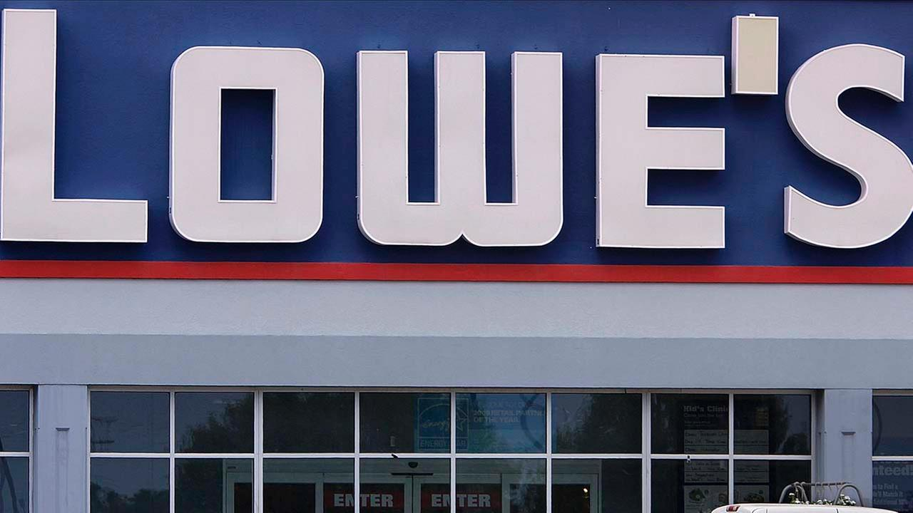 In this file photo taken July 8, 2009, a shopper exits the Lowes home improvement center in Springfield, Ill.