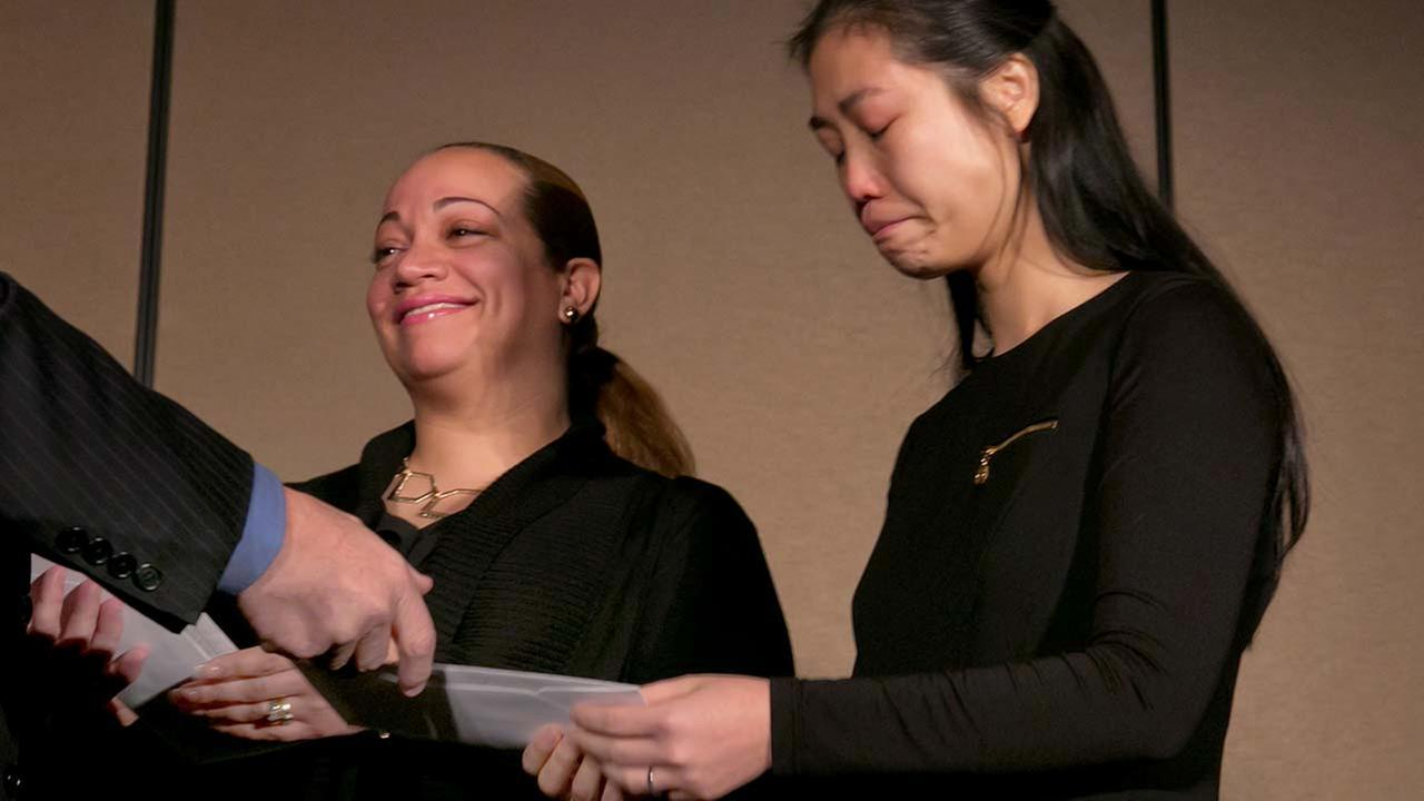 Maritza Ramos, left, and Pei Xia Chen, widows of slain NYPD officers Rafael Ramos and Wenjian Liu, receive checks from the Stephen Siller Tunnel to Towers Foundation