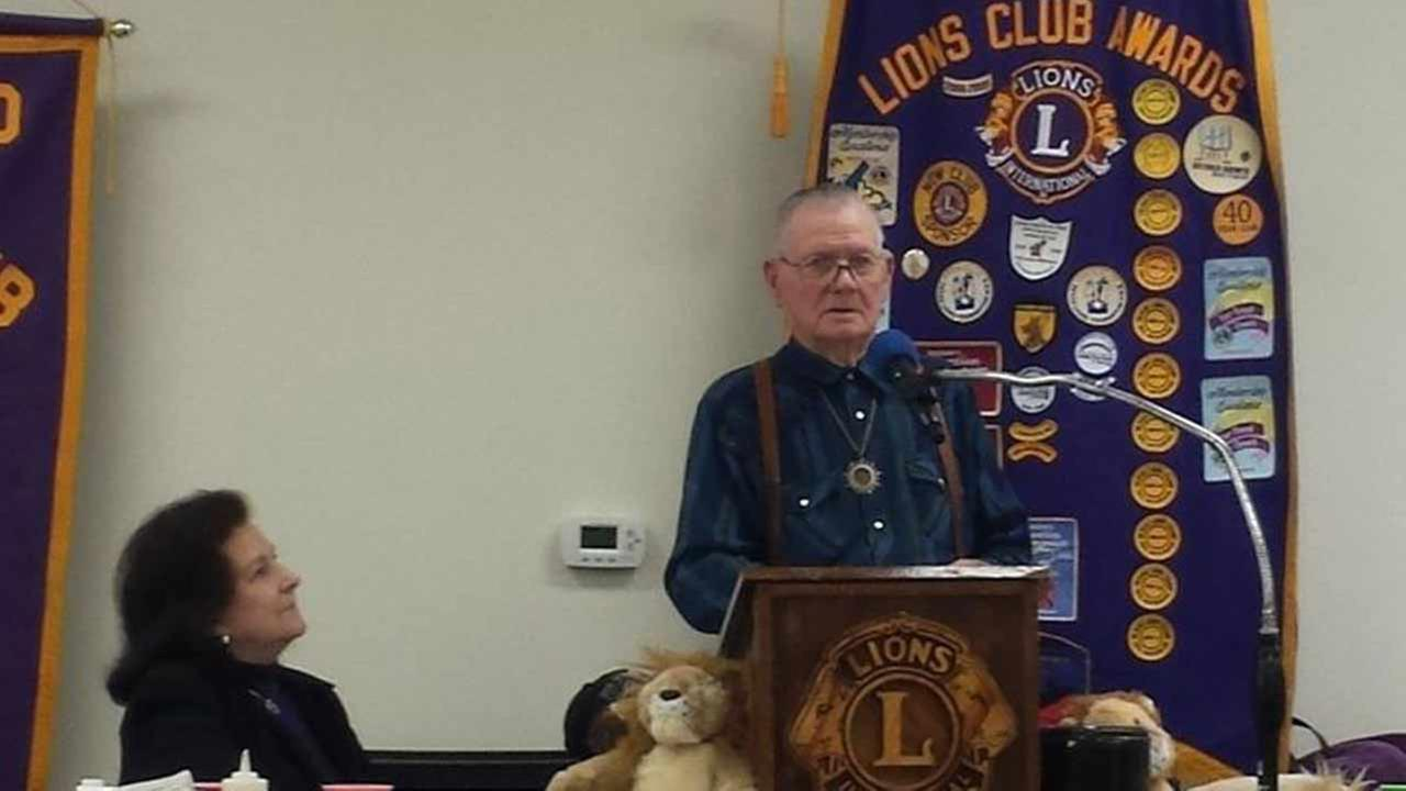 Former World War II prisoner of war Cliff Miller spoke at the meeting of the Cleveland Lions Club, where he posed with club members.