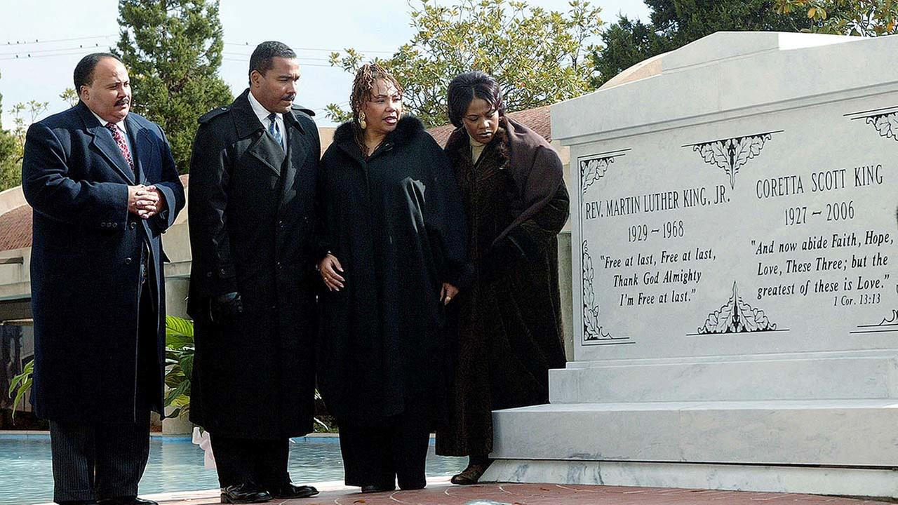 The children of the Rev. Martin Luther King Jr. and Coretta Scott King from left, Martin Luther King III, Dexter King, the late Yolanda King and Bernice King stand next to a crypt