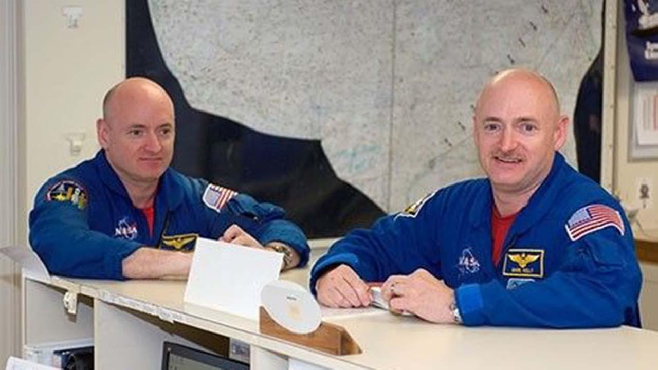 Astronauts Mark Kelly, right, and Scott Kelly are pictured in the check-out facility at Ellington Field near NASAs Johnson Space Center