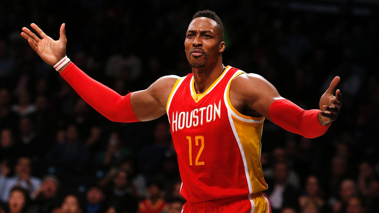 Houston Rockets Dwight Howard (12) reacts to a no-call after going to the basket against the Brooklyn Nets during the second quarter of an NBA basketball game on Jan. 12, 2015
