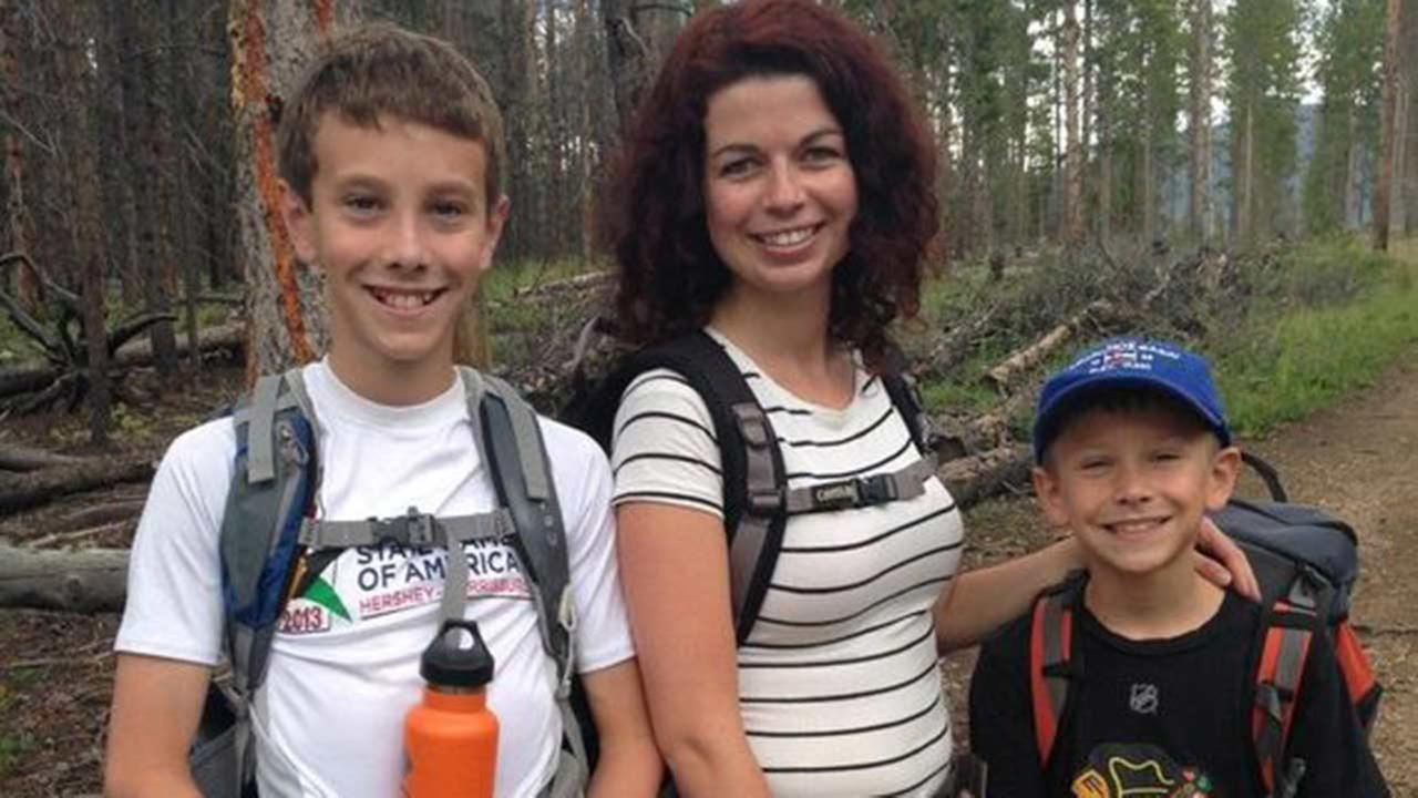 Au Pair Kinga Pikon cares for Max, left, and Zane, right, Oberg.