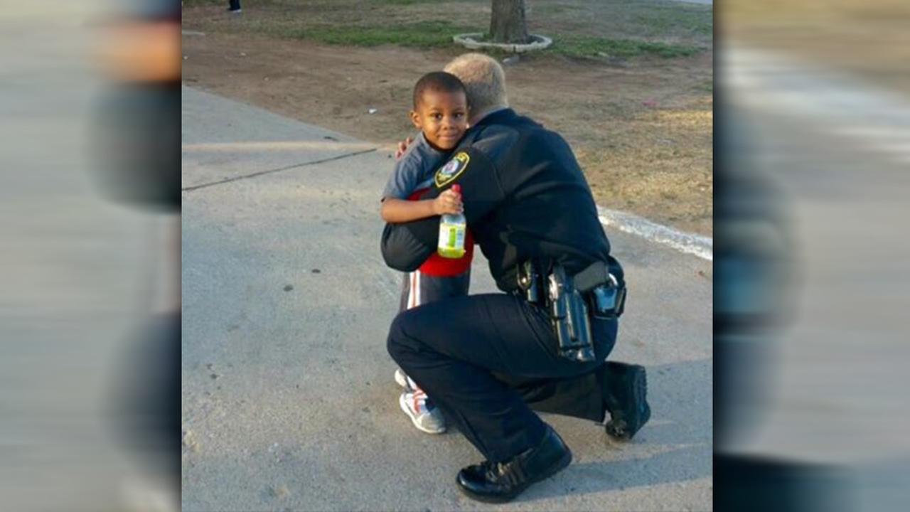 Officer hugs boy