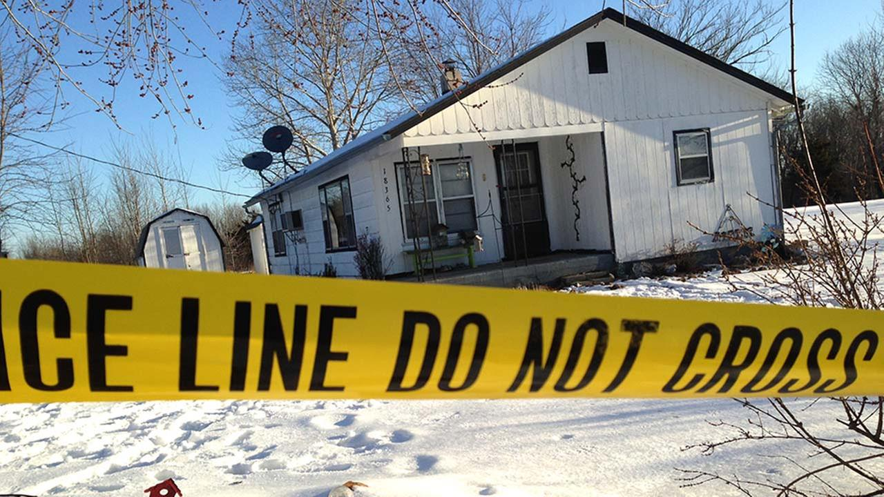 Police tape surrounds one of the crime scenes in Tyrone, Mo., Friday, Feb. 27, 2015