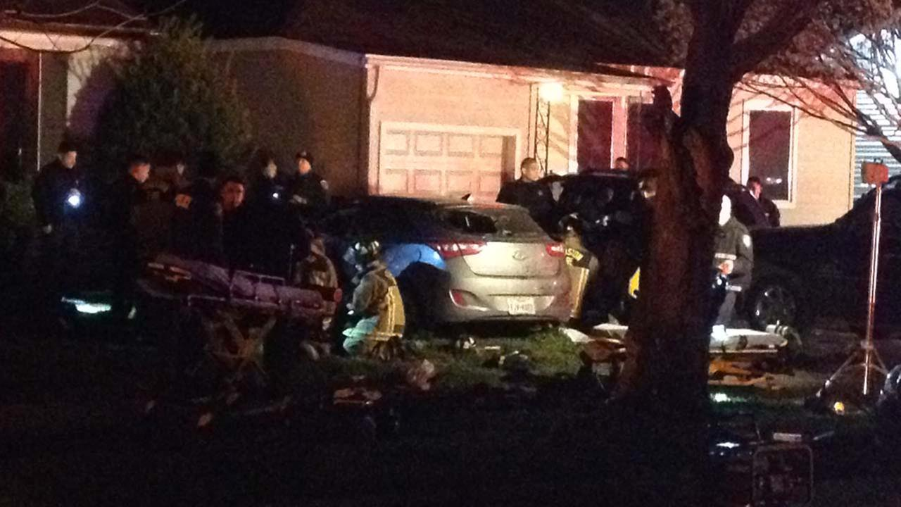 The scene after the car slammed into a tree following the police chase.