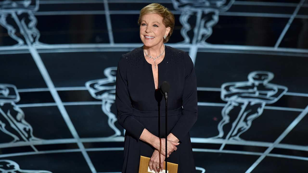 Julie Andrews presents the award for best original score at the Oscars on Sunday, Feb. 22, 2015, at the Dolby Theatre in Los Angeles.