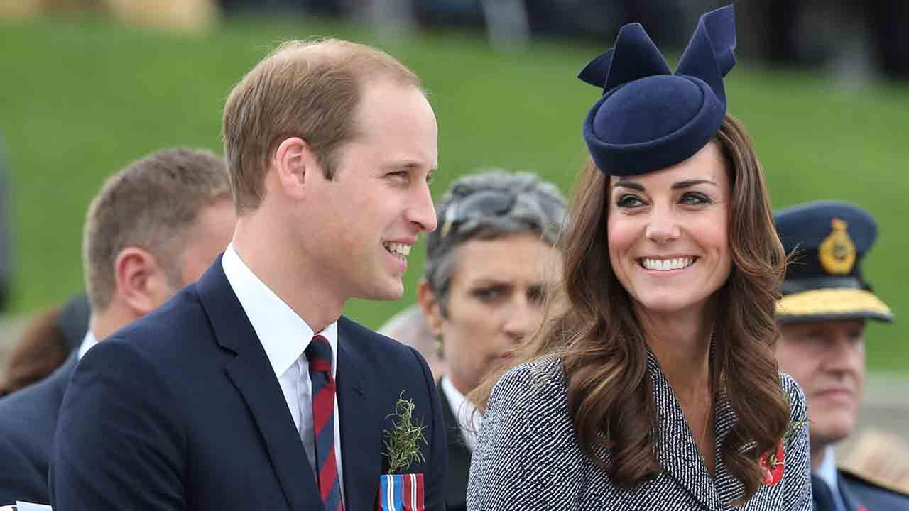Britains Prince William and his wife Kate, the Duchess of Cambridge, chat during the Anzac Day parade at the Australian War Memorial in Canberra, Australia, Friday, April 25, 2014. The Duke and Duchess attended the memorial as the last engagement of thei