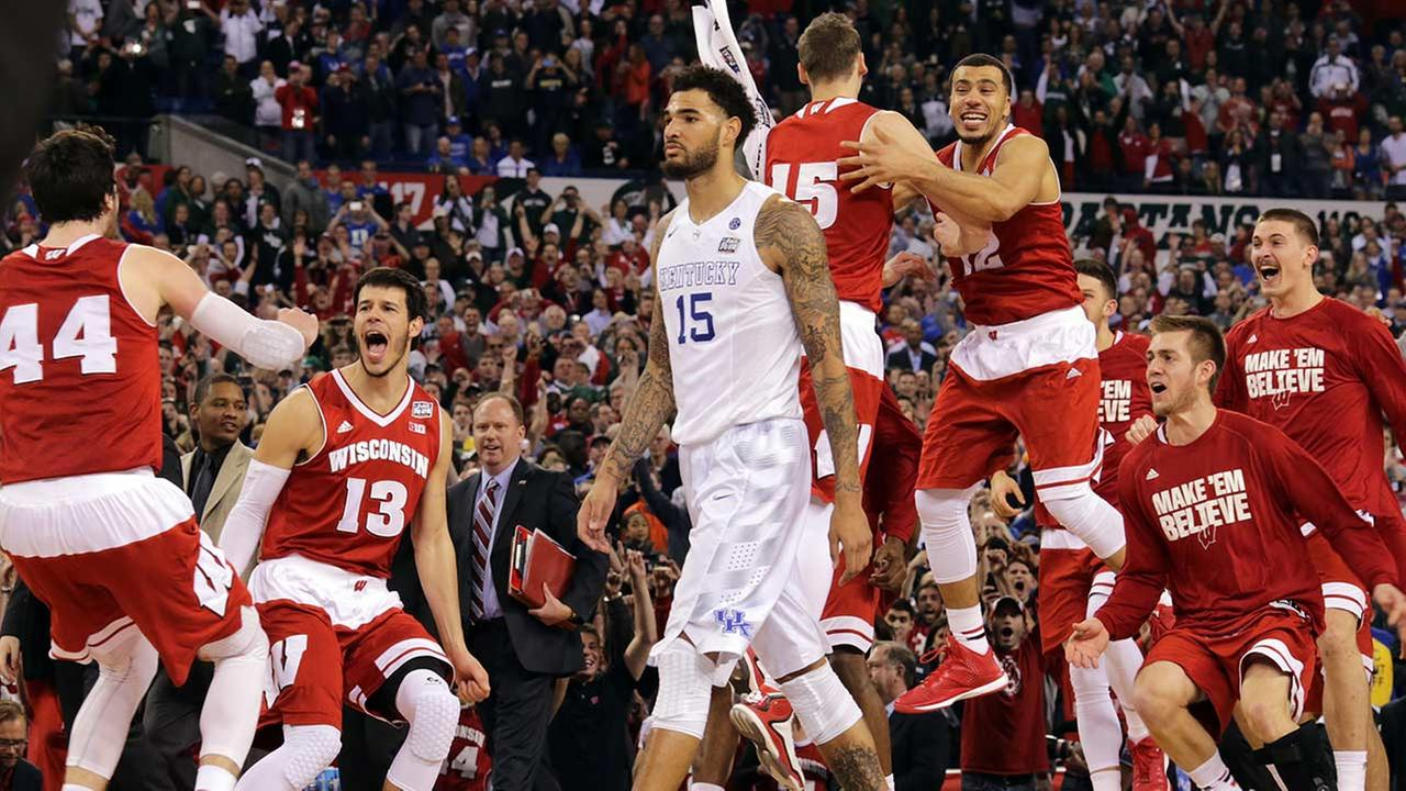 Wisconsin bench celebrates as Kentuckys Willie Cauley-Stein walks off after the NCAA Final Four tournament college basketball semifinal game April 4, 2015, in Indianapolis.
