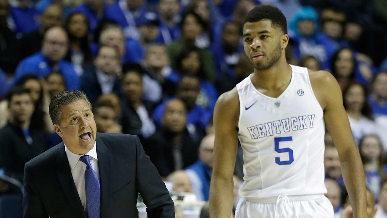 Kentucky head coach John Calipari speaks to Kentucky guard Andrew Harrison (5) during the first half of an NCAA college basketball game against Florida.
