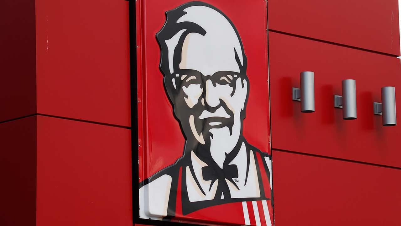 In this Tuesday, Oct. 9, 2012 photo, a close-up of a sign with a picture of Colonel Sanders is shown on the wall of a combination Kentucky Fried Chicken.