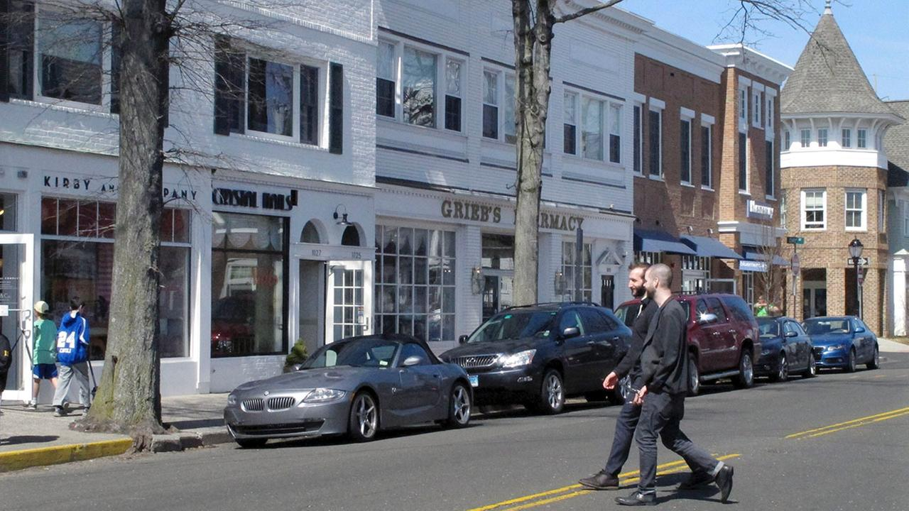 In this April 6, 2015 photo, pedestrians cross a street in downtown Darien, Conn.