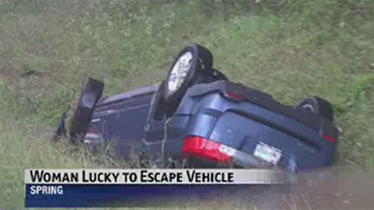 Woman escapes vehicle after flipping into water filled ditch